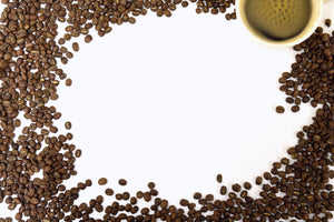 Image of spilled beans and a cup of black brewed coffee for talking crow coffee roasters website