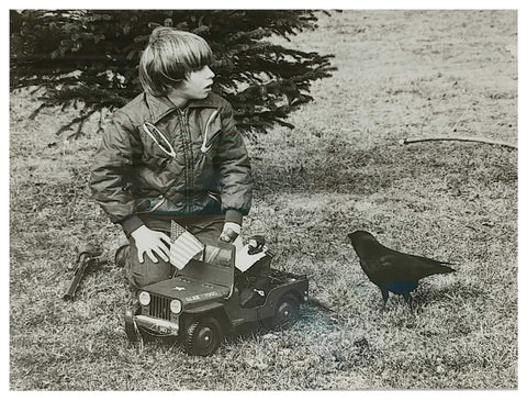 Vintage image of young eric and tony the crow playing with a GI Joe character
