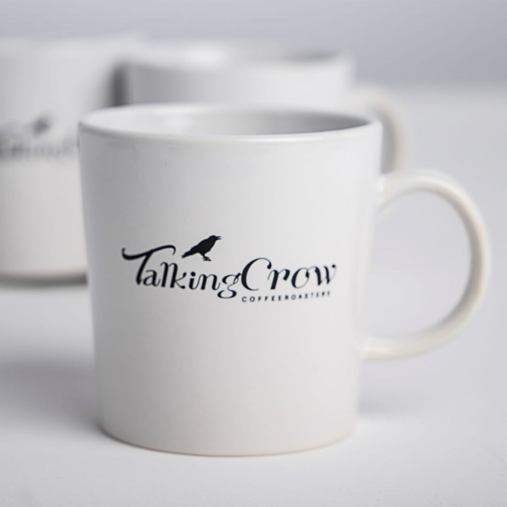 14 oz White Stoneware Coffee Mug With Black Talking Crow Coffee Roasters Logo