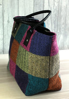 side view of tweed patchwork bag