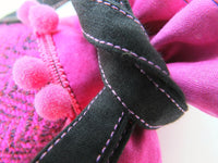 Detail of hot fuschia pink draw tie tweed bag