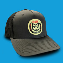 Load image into Gallery viewer, Bushido black trucker hat with yellow fox logo patch