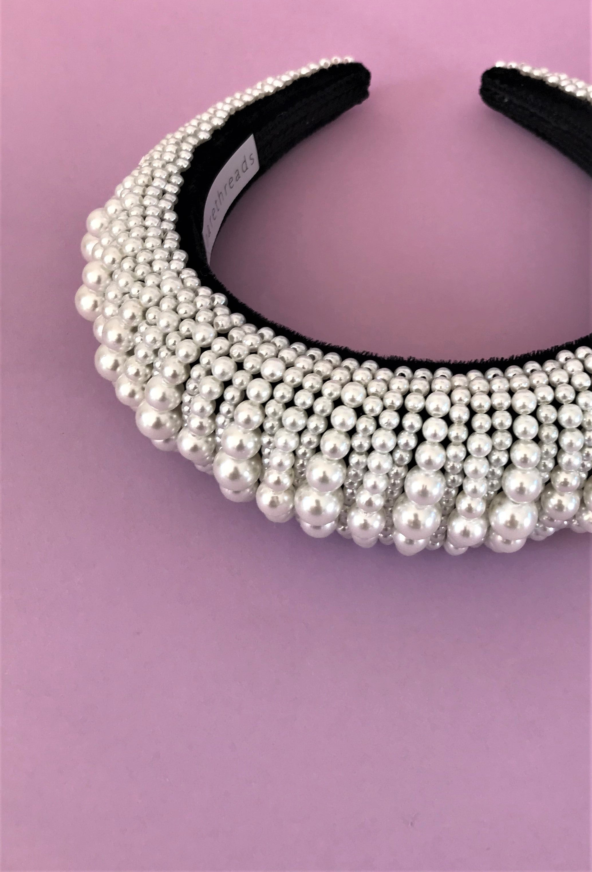 THE ASTERIA PADDED PEARL BAND