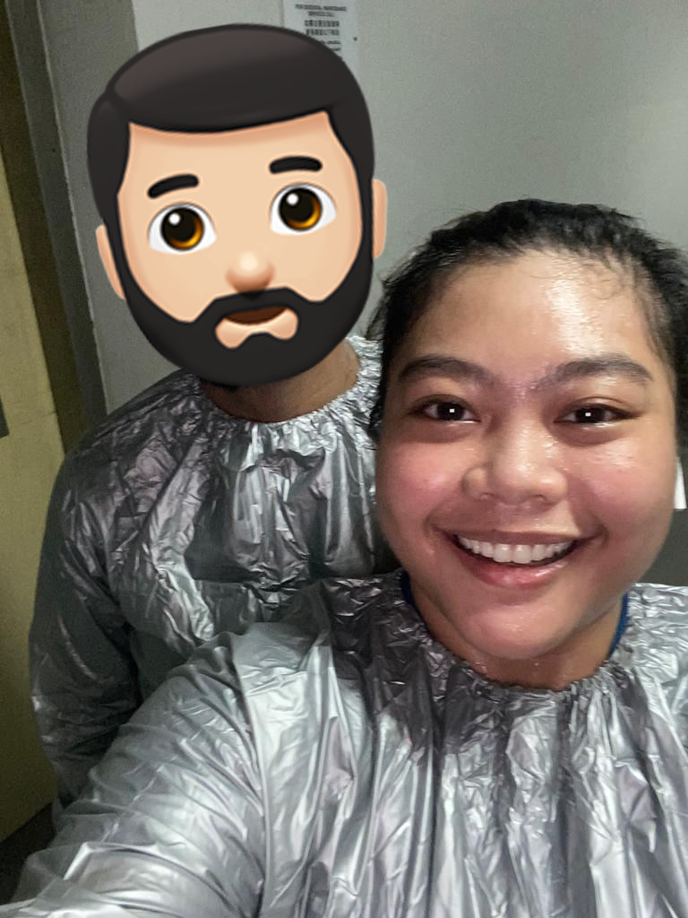 Fah and her husband wearing their sauna suits!