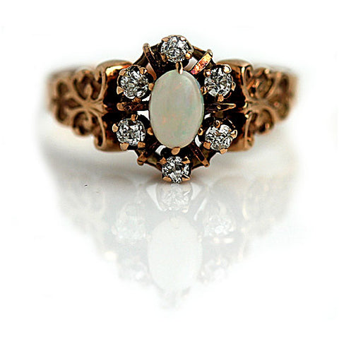 https://vintagediamondring.com/collections/vintage-antique-opal-engagement-rings/products/victorian-opal-and-mine-cut-diamond-engagement-ring?variant=28345284558912