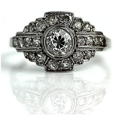 Bezel Set Diamond Halo Ring in Platinum