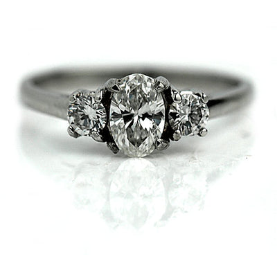 Oval Cut Diamond Engagement Ring with Side Stones