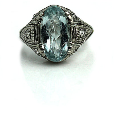 Oval Cut Aquamarine Engagement Ring with Side Diamonds