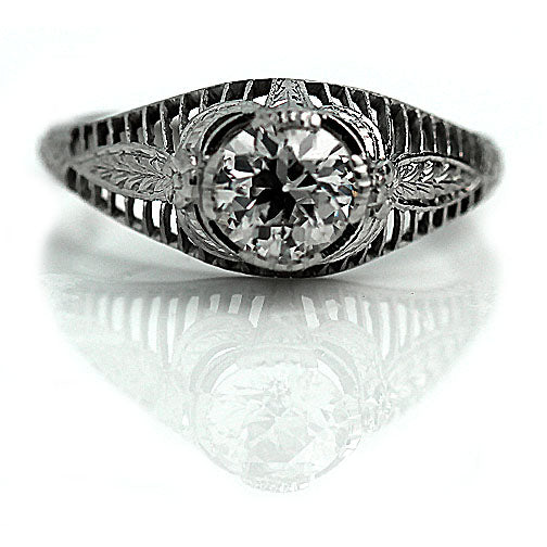 Classic Diamond Engagement Ring with Floral Engravings