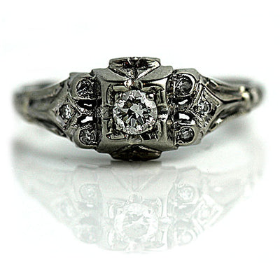 Vintage Engagement Ring with Bezel Set Diamonds