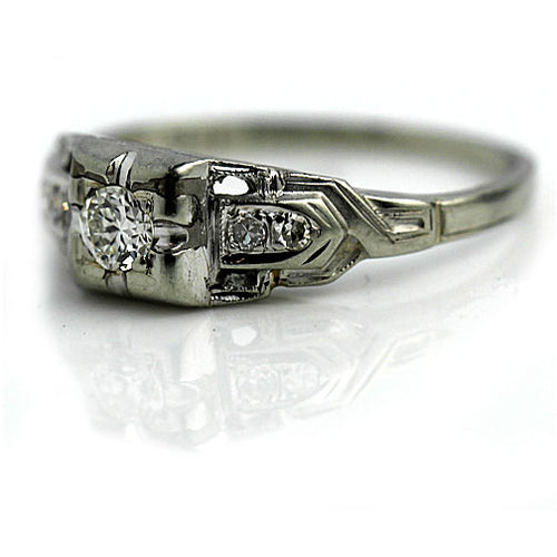 Delicate Engagement Ring with Side Diamonds
