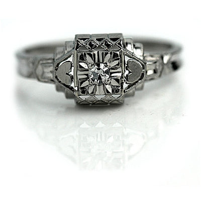 Solitaire Diamond Engagement Ring with Heart Motif