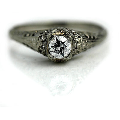 Solitaire Diamond Ring with Filigree Engravings