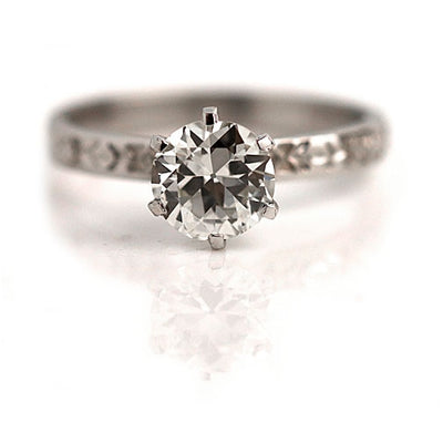 Vintage Solitaire Engagement Ring with Engraved Band