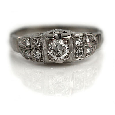 Vintage Diamond Engagement Ring with Tiered Side Stones