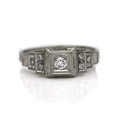 Intricate Diamond Engagement Ring with Tiered Side Diamonds