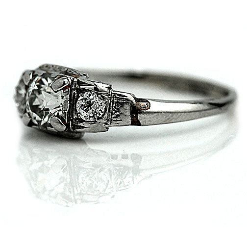 Low Profile Platinum Engagement Ring with Side Diamonds