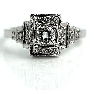 Halo Engagement Ring with Tiered Side Diamonds