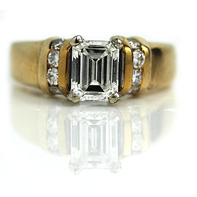 Vintage Emerald Cut Diamond Engagement Ring with Side Stones