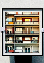 Load image into Gallery viewer, 49 Via Dezza, a multi coloured block of flats in Milan, photographed by Richard Heeps at Sunset.