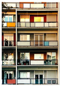 49 Via Dezza, a multi coloured block of flats in Milan, photographed by Richard Heeps at Sunset.