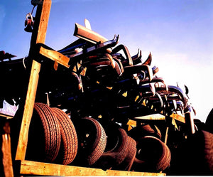 A set of photographs that followed a straight line. The images would go through, over and under what ever came in the path of the camera's lens: tyres, scrapyard, sky.