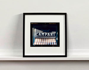 Cordial Campari, photographed as part of Richard Heeps' series 'A Short History of Milan' features beautiful and bold typography above the striped awning of a fascist building.