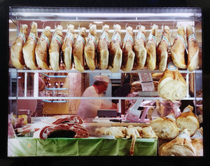 A traditional Italian delicatessen, selling prosciutto, ham and cured meats on the streets of Milan.