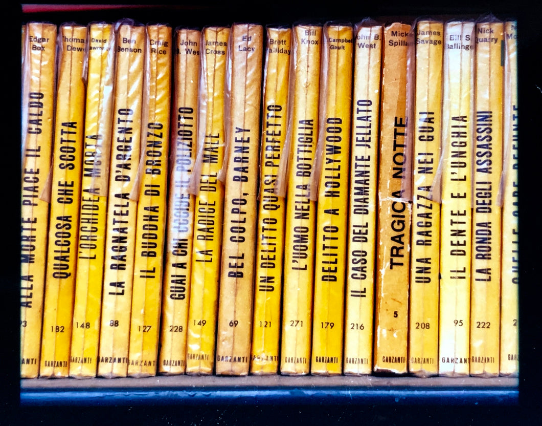 As part of Richard Heeps' series, A Short History of Milan, Delitto A Hollywood features a series of yellow Italian books from a street kiosk.