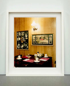 This photograph was taken inside the dining room of the iconic Parry Lodge in Kanab, Utah, which once hosted movie stars of the Western films made in the area. Their faces, cutouts from Life Magazine, adorned the wood panelled walls, which combined with the vintage interior, creates a mid-century cinematic atmosphere. This piece is part of Richard Heeps' 'Dream in Colour' series.