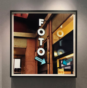 A vintage neon sign outside of a Foto Studio in Milan.