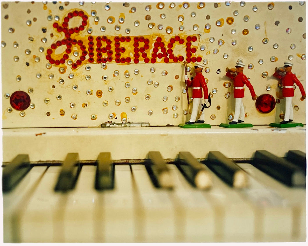Liberace's Piano, part of Richard Heeps 'Dream in Colour' Series, it has an archetypal Las Vegas feel, featuring marching band and piano keys.