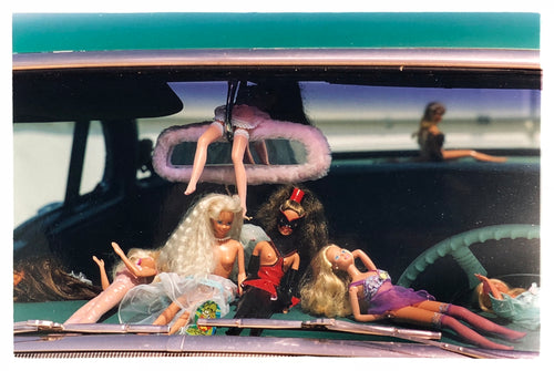 'Oldsmobile & Sinful Barbie's' photographed in, Las Vegas, Nevada, is part of Richard Heeps 'Man's Ruin' Series. This artwork makes up the three piece sequence: 'Wendy Flamin' Eyeball', 'Wendy Resting' & 'Oldsmobile and Sinful Barbie's' shot at the Rockabilly Weekender, Viva Las Vegas. Here this is a brilliantly adult version of the iconic Barbie Doll on the dashboard of a classic American Car.