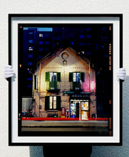 Load image into Gallery viewer, The traditional Italian Tobacconist shop, here in a Swiss Cottage style building set against a vast urban apartment block.