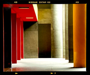 Italian designed brutalist architecture in Milan, featuring red and yellow pillars.