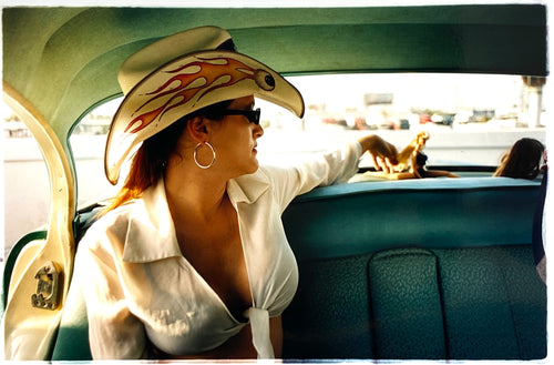 Wendy and Dolls, from Richard Heeps 'Man's Ruin' Series, this is part of a sequence of artworks capturing Wendy at the Rockabilly Weekender, Viva Las Vegas. This cinematic portrait of Wendy captures her in the back seat of her classic American Oldsmobile.