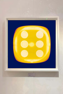 From Heidler & Heeps Dice Series, a yellow dice suspended on an inky blue background.