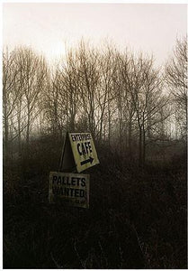 A set of photographs that followed a straight line. The images would go through, over and under what ever came in the path of the camera's lens: trees, sign, hand-painted sign, woodlands.