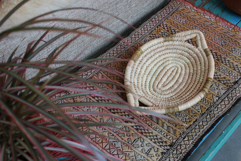Moroccan basket on woven carpet