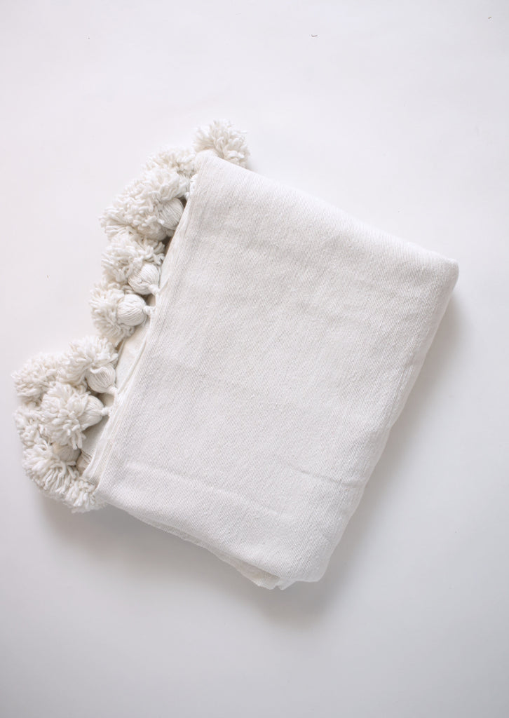 Moroccan pom pom blanket in white