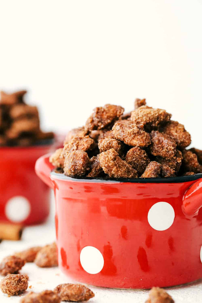 Slow Cooker Cinnamon Almonds are a crunchy, sweet treat made perfectly delicious in the crockpot! These tasty vittles are perfect for snacking, gift giving, and holiday partie