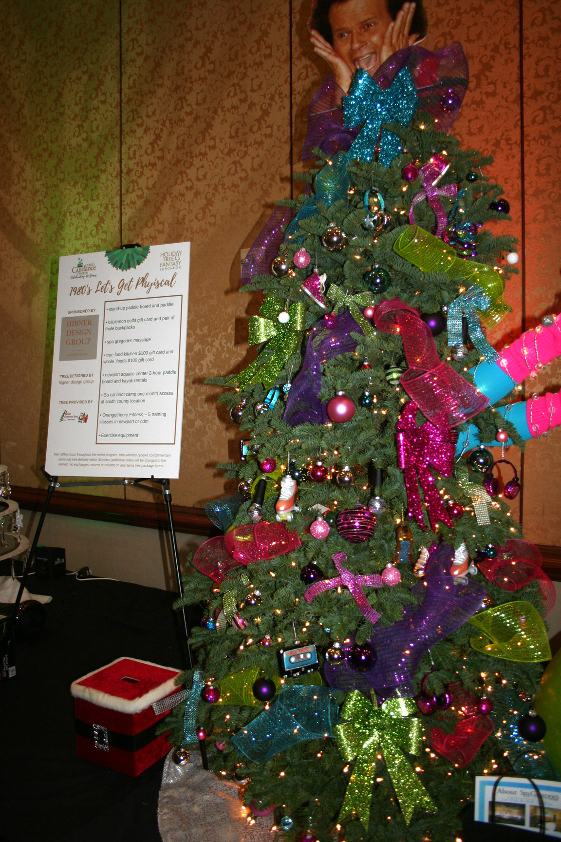 A 80s themed Christmas tree next to an information board titled 1980's Let's get physical