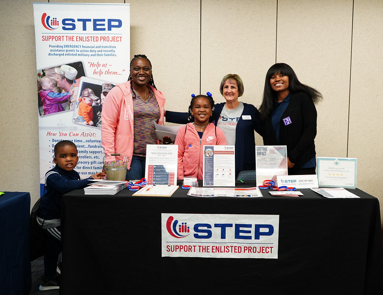 Five people posing at the vendor table of STEP