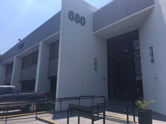 Entrance to white building labeled as 680, the Fullerton Facility