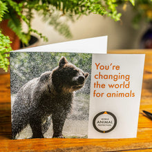 Load image into Gallery viewer, Gifts to support animals. A bear leaving a river. Picture credit: www.martinusborne.com