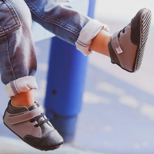A close-up view of gray Emmerson children's barefoot shoe by Jack & Lily