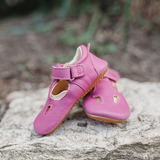 Froddo Pre Walker Pink Shoes sitting on rock in nature healthy baby shoes minimalist shoes