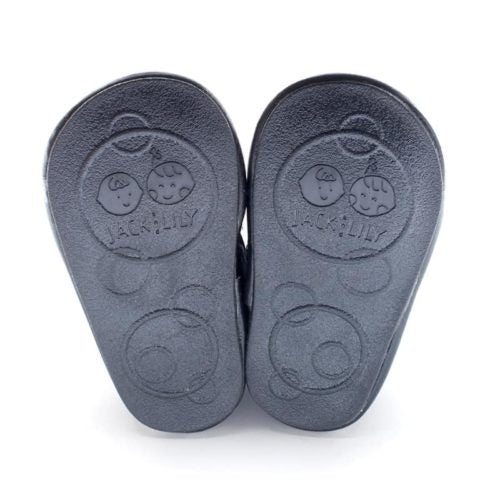 The soles of Jack and Lily's Arlo children's barefoot shoe in black