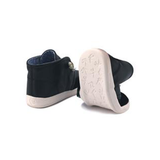 A back view of kids flexible sole PaperKrane's Slick Black children's barefoot shoe in black