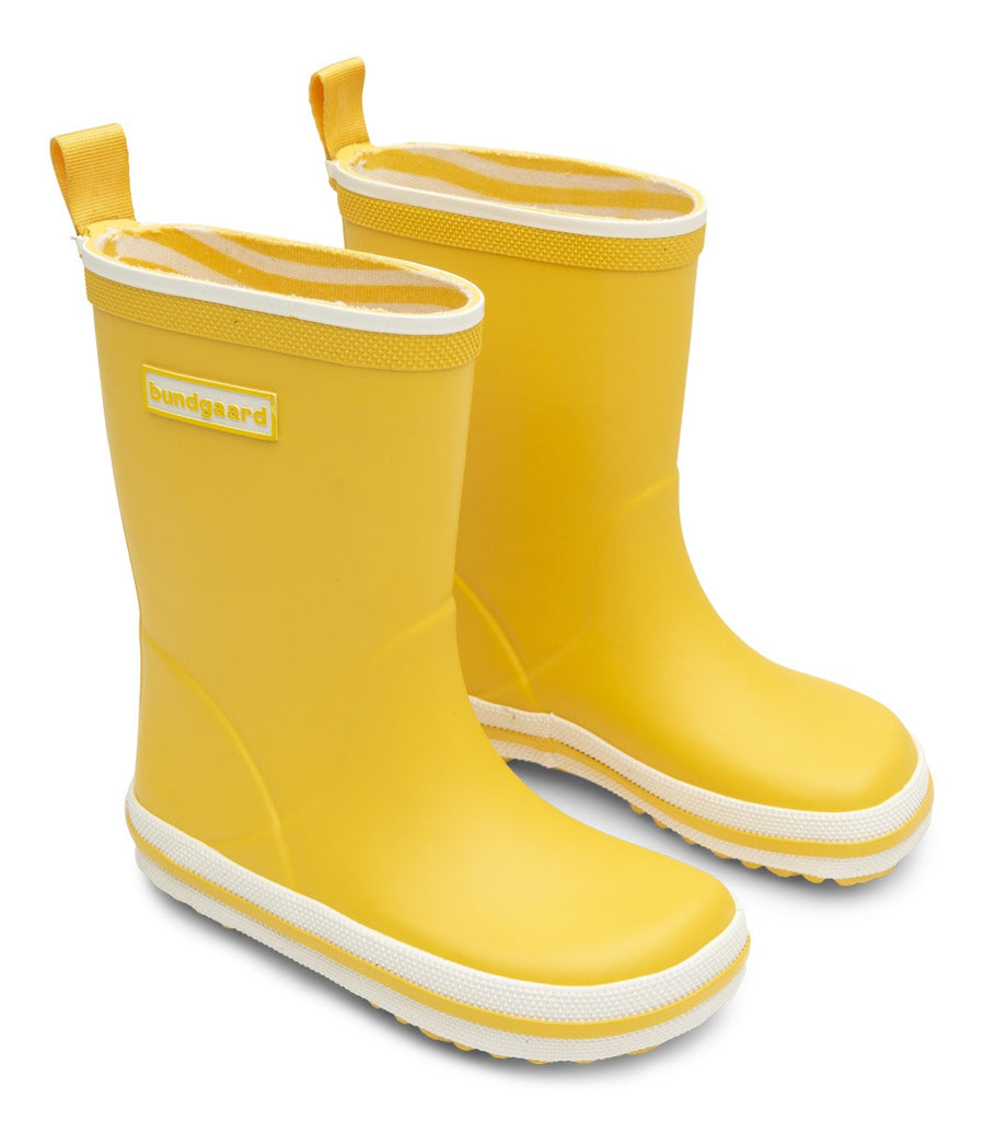 A side view of a pair of Bundgaard's yellow Sunflower Classic Rubber Boot children's barefoot boots